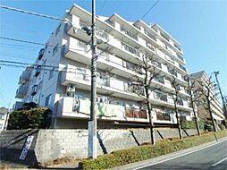 東京都多摩市馬引沢2丁目の賃貸マンションの外観