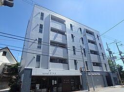 大阪府池田市井口堂1丁目の賃貸マンションの外観