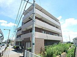 東京都日野市大字新井の賃貸マンションの外観