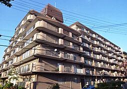 大阪府吹田市千里山松が丘の賃貸マンションの外観