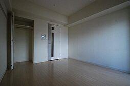 プレサンス泉アーバンゲートの洋室