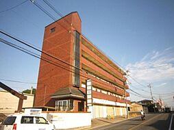 京都府京田辺市三山木垣ノ内の賃貸マンションの外観