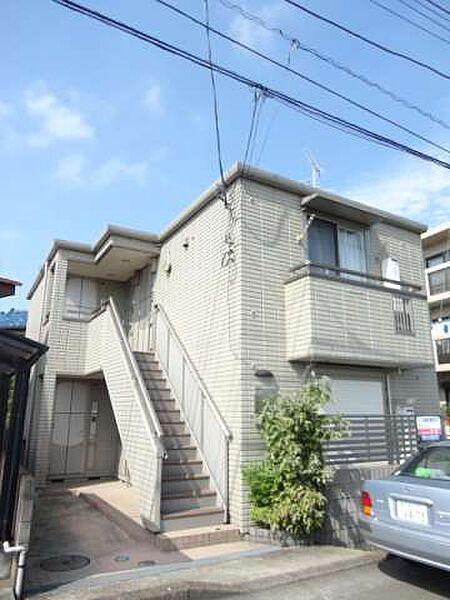 東京都多摩市一ノ宮2丁目の賃貸マンションの外観