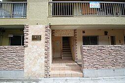 七福コーポ[4階]の外観