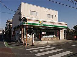 草加松原マンション[303号室]の外観