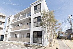 ガーデンヒルズ六高台C棟[202号室]の外観