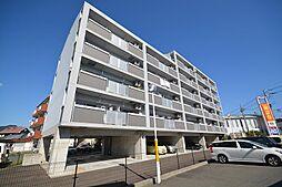 福岡県行橋市行事3丁目の賃貸マンションの外観
